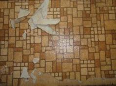 Asbestos paper lining to brown floor covering