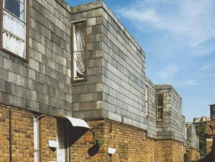 Wall clad with asbestos cement tiles on the first floor level
