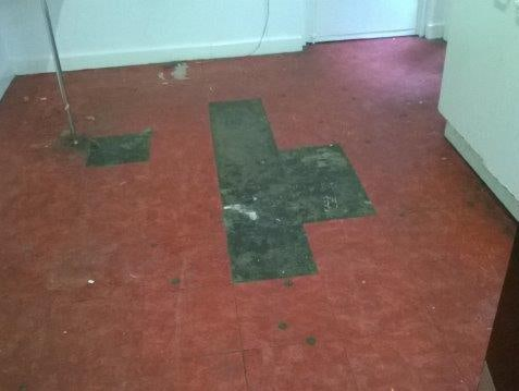 Red Asbestos Floor Tiles There are a few tiles missing showing the asbestos containing bitumen adhesive